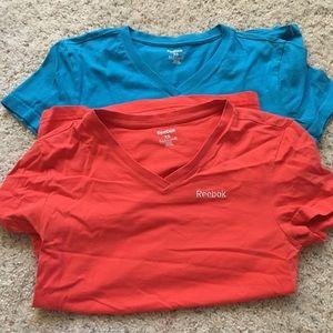 Two Reebok exercise shirts